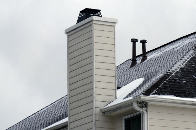 Ice dam on roof behind chimney near Raleigh, NC by Rick Nipper