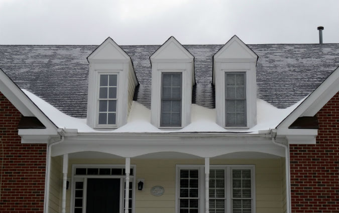 Ice dams on roof at dormers by Rick Nipper near Raleigh, NC