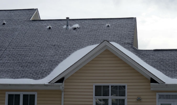 Ice dams caused by sleet on upper roof that collects at eave by Rick Nipper near Raleigh, NC